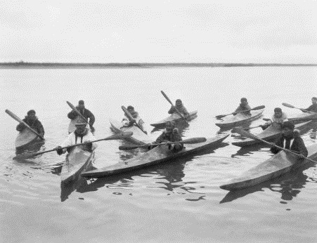 Inuits in kayaks